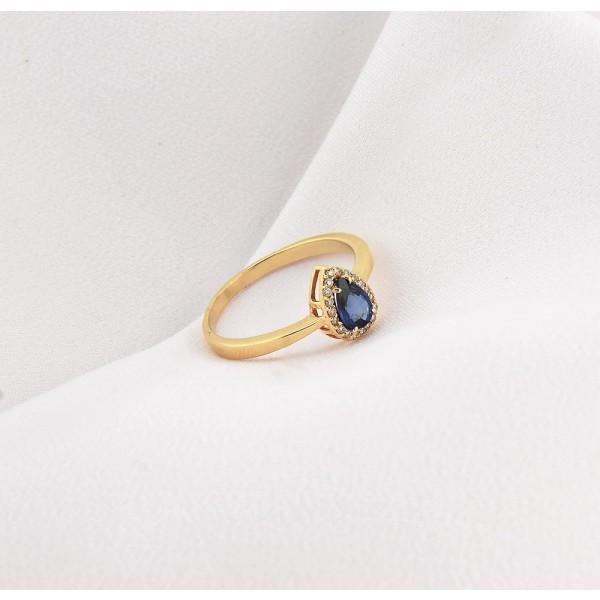 Anel com Safira azul com Brilhantes em ouro amarelo 18k.
